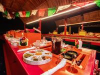 Delight with exquisite Mexican food and sing all night long at Xoximilco Cancun